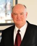 Mr. Bruce L. Smith
